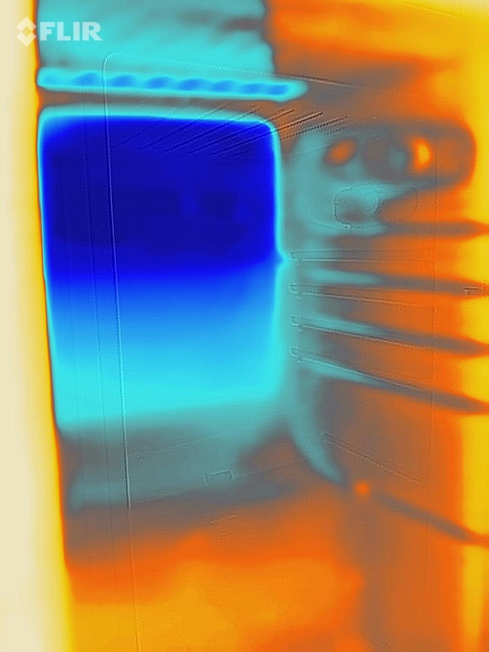 Thermal image of the inside of fridge showing hot spots