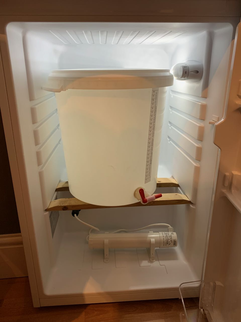 A modified fridge, showing the fermentation bucket fitting well