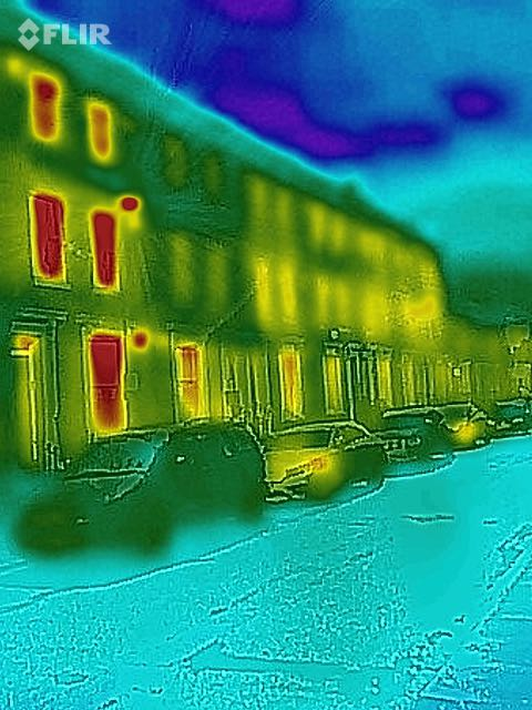 A thermal image showing the houses on my street, highlighting how windows     leak so much heat