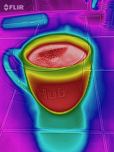 A mug of tea, showing where the liquid is hot and the mug itself is     warmiing up